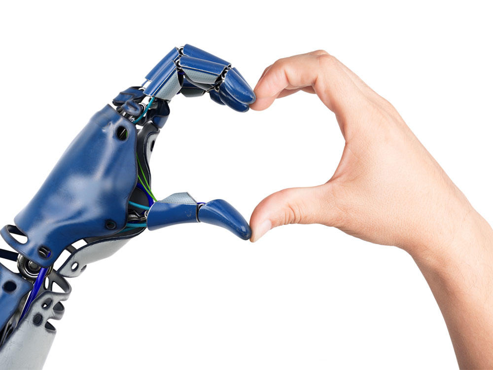 Robot hand and a human hand making a heart