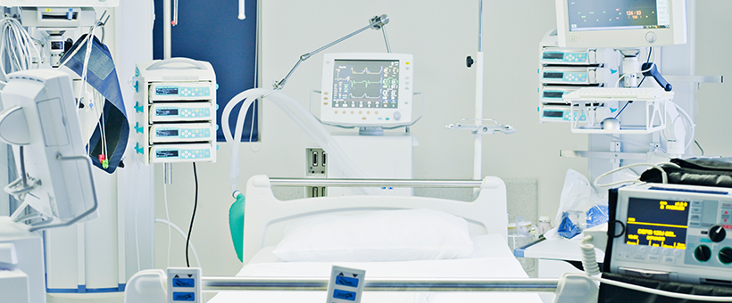 Respiratory equipment and medical devices surrounding a hospital bed