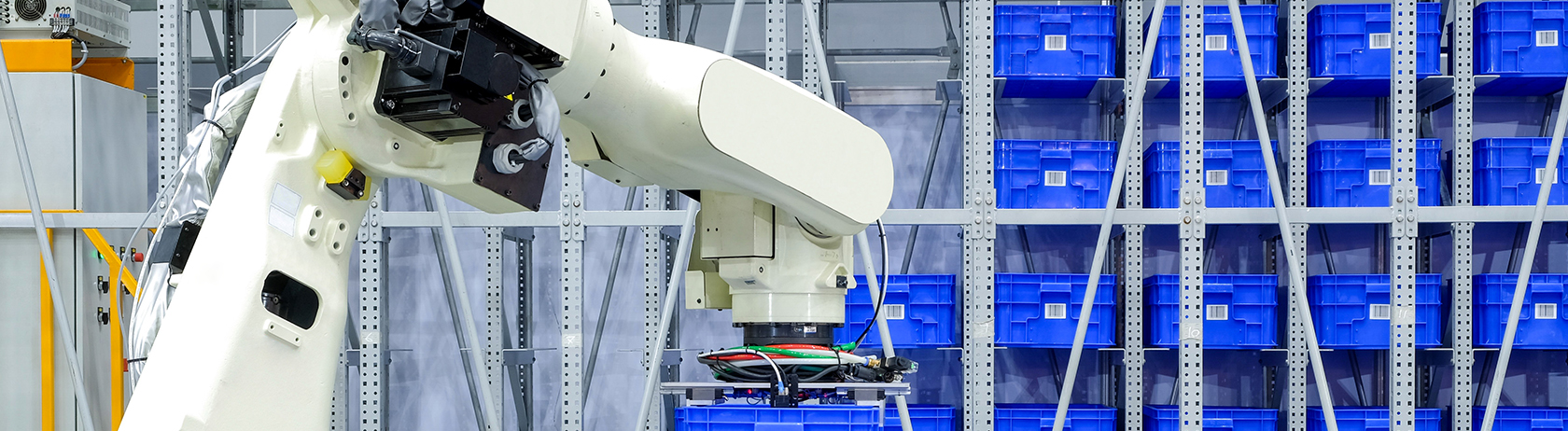 Smart logistics shown with an industrial robotic working in a factory warehouse