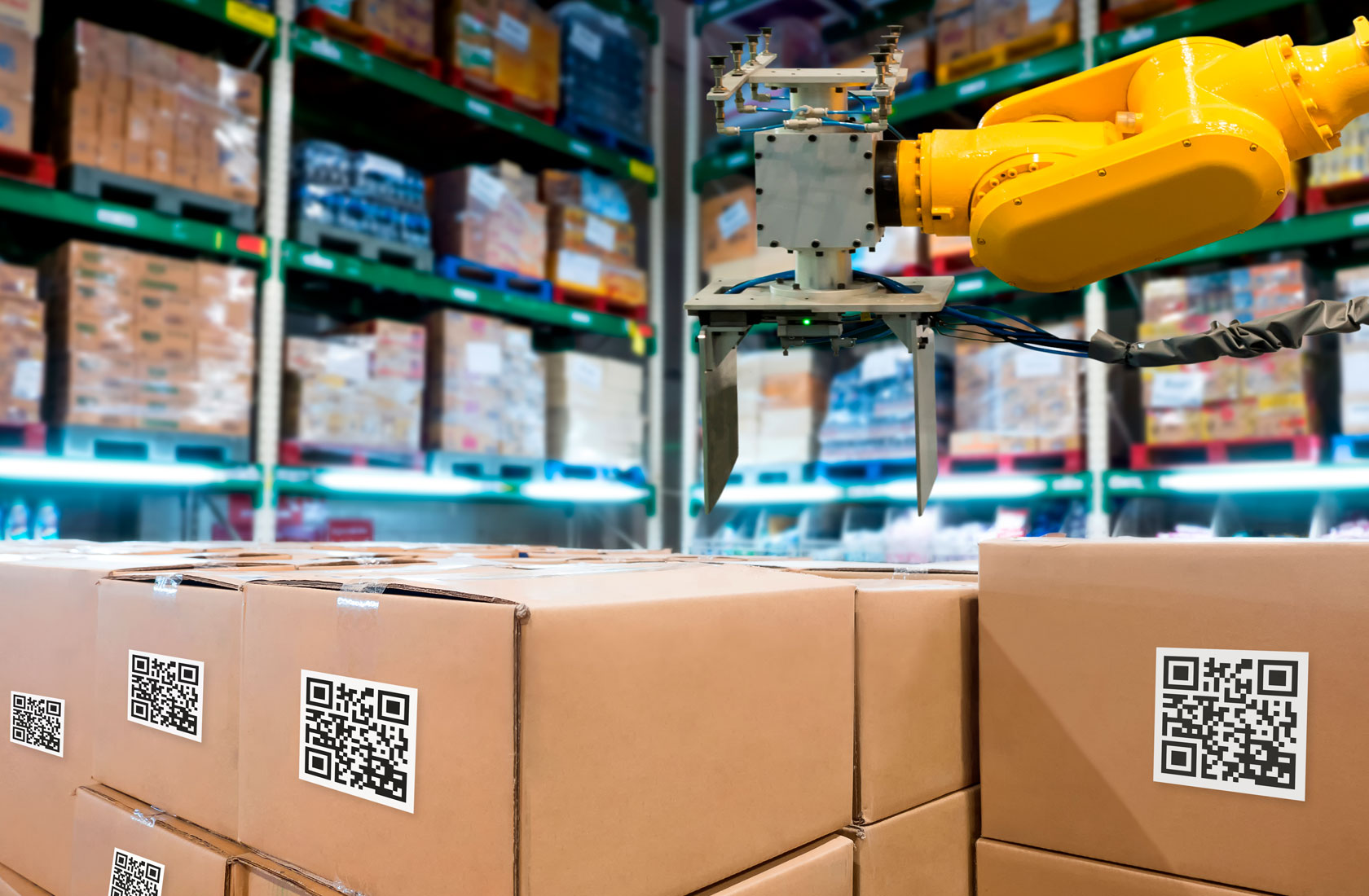 QR Labelled packages in warehouse with robotic arm
