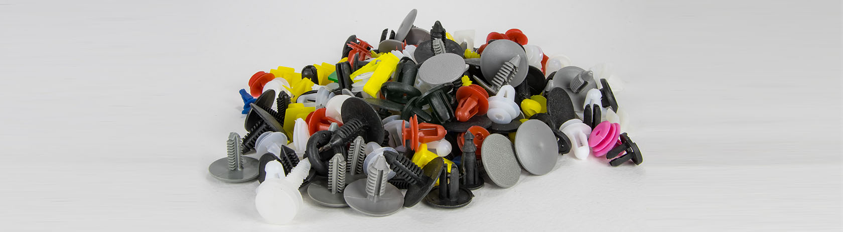 Pile of plastic rivets in different shapes and sizes